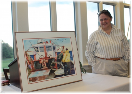 Watercolor artist Kate Somers with her painting